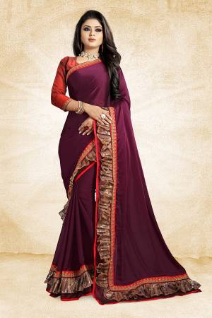 Celebrate This Festive Season With Beauty And Comfort Wearing This Designer Saree In Wine Color Paired With Contrasting Red Colored Blouse. This Saree Is Fabricated On Georgette Paired With Art Silk Fabricated Blouse. It Has Fancy Lace Border Giving It An Attractive Look.
