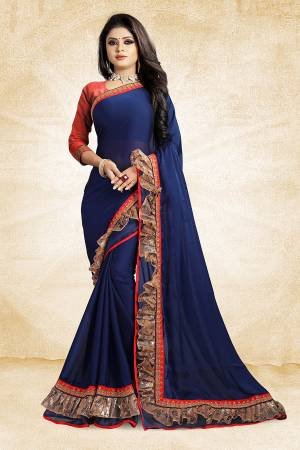 Celebrate This Festive Season With Beauty And Comfort Wearing This Designer Saree In Blue Color Paired With Contrasting Red Colored Blouse. This Saree Is Fabricated On Georgette Paired With Art Silk Fabricated Blouse. It Has Fancy Lace Border Giving It An Attractive Look.