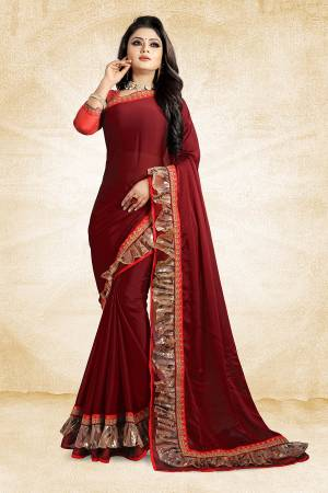 Celebrate This Festive Season With Beauty And Comfort Wearing This Designer Saree In Maroon Color Paired With Contrasting Red Colored Blouse. This Saree Is Fabricated On Georgette Paired With Art Silk Fabricated Blouse. It Has Fancy Lace Border Giving It An Attractive Look.