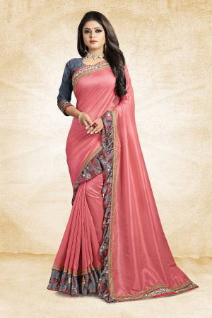 Look Pretty Wearing This Designer Silk Based Saree In Pink Color Paired With Grey Colored Blouse. This Saree And Blouse Are Silk Based Beautified With Lace Border And Printed Frill Over The Border. Buy This Pretty Saree Now.