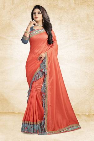 Look Pretty Wearing This Designer Silk Based Saree In Orange Color Paired With Grey Colored Blouse. This Saree And Blouse Are Silk Based Beautified With Lace Border And Printed Frill Over The Border. Buy This Pretty Saree Now.