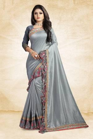 Look Pretty Wearing This Designer Silk Based Saree In Grey Color Paired With Grey Colored Blouse. This Saree And Blouse Are Silk Based Beautified With Lace Border And Printed Frill Over The Border. Buy This Pretty Saree Now.
