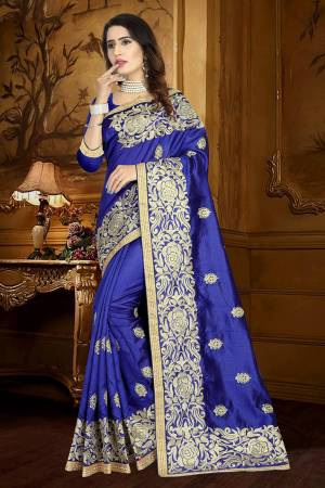 Catch All The Limelight Wearing This Heavy Designer Saree In Royal Blue Color Paired With Royal Blue Colored Blouse. This Saree And Blouse Are Fabricated On Art Silk Beautified With Resham Embroidery And Lace Border.