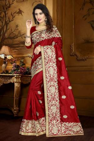 For A Rich And Elegant Look, Grab This Designer Saree In Maroon Color Paired With Maroon Colored Blouse. This Saree And Blouse Are Silk Based Beautified With Resham Embroidery And Lace Border. Buy This Rich Looking Saree Now.