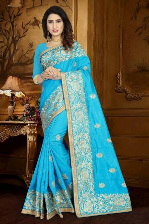 Simple And Elegant looking Designer Saree Is Here In Sky Blue Color Paired With Sky Blue Colored Blouse. This Saree And Blouse Are Silk Based Beautified With Heavy And Attractive Embroidery. Buy Now.