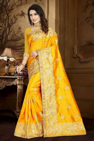 Celebrate This Festive Season Wearing This Rich Silk Based Saree In Yellow Color Paired With Yellow Colored Blouse. This Saree And Blouse Are Fabricated On Art Silk Beautified With Embroidery And Lace Border.