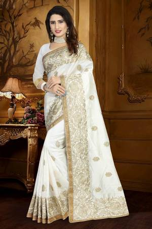 Catch All The Limelight Wearing This Heavy Designer Saree In White Color Paired With White Colored Blouse. This Saree And Blouse Are Fabricated On Art Silk Beautified With Resham Embroidery And Lace Border.