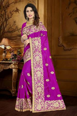 For A Rich And Elegant Look, Grab This Designer Saree In Magenta Pink Color Paired With Magenta Pink Colored Blouse. This Saree And Blouse Are Silk Based Beautified With Resham Embroidery And Lace Border. Buy This Rich Looking Saree Now.