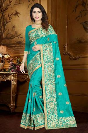 Simple And Elegant looking Designer Saree Is Here In Turquoise Blue Color Paired With Turquoise Blue Colored Blouse. This Saree And Blouse Are Silk Based Beautified With Heavy And Attractive Embroidery. Buy Now.