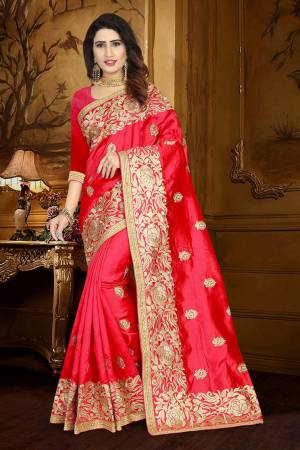 Celebrate This Festive Season Wearing This Rich Silk Based Saree In Red Color Paired With Red Colored Blouse. This Saree And Blouse Are Fabricated On Art Silk Beautified With Embroidery And Lace Border.