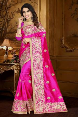 For A Rich And Elegant Look, Grab This Designer Saree In Fuschia Pink Color Paired With Fuschia Pink Colored Blouse. This Saree And Blouse Are Silk Based Beautified With Resham Embroidery And Lace Border. Buy This Rich Looking Saree Now.