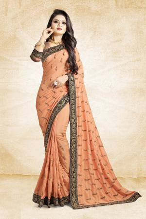 For Rich, Heavy And Elegant Look, This Saree Is Suitable For All. Grab This Designer Saree In Light Orange Color Paired With Light Orange Colored Blouse. This Saree And Blouse Are Silk Based Beautified With Embroidered Buttis And Lace Border. Buy Now.