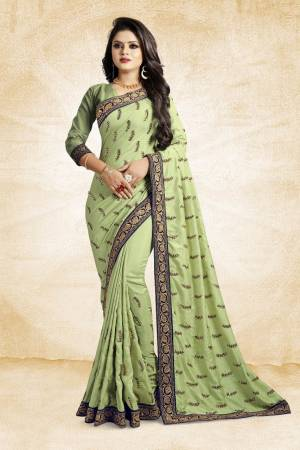 For Rich, Heavy And Elegant Look, This Saree Is Suitable For All. Grab This Designer Saree In Light Green Color Paired With Light Green Colored Blouse. This Saree And Blouse Are Silk Based Beautified With Embroidered Buttis And Lace Border. Buy Now.