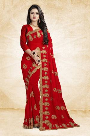 This Festive Season, Grab This Designer Saree In Red Color Paired With Red Colored Blouse. This Saree And Blouse Are Georgette Based Beautified With heavy Attractive Embroidery.