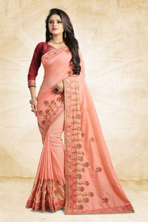 Look Pretty In This Lovely Designer Saree In Peach Color Paired With Maroon Colored Blouse. This Pretty Embroidered Saree In Fabricated On Satin Silk Paired With Art Silk Fabricated Blouse. It Has Contrasting Colored Embroidery Giving The Saree An Attractive Look.