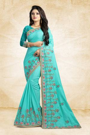 Look Pretty In This Lovely Designer Saree In Blue Color Paired With Blue Colored Blouse. This Pretty Embroidered Saree In Fabricated On Satin Silk Paired With Art Silk Fabricated Blouse. It Has Contrasting Colored Embroidery Giving The Saree An Attractive Look.