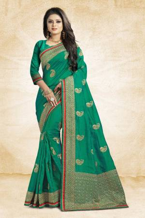 Grab This Designer Silk Based Saree In Green Color Paired With Green Colored Blouse. This Saree And Blouse Are Fabricated On Art Silk Beautified With Jari Embroidery And Stone Work. Buy Now.