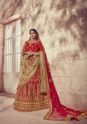 Get Ready For Your Big Day With This Heavy Designer Lehenga Choli In Red Color. This Heavy Embroidered Lehenga Choli Is Fabricated On Art Silk Paired With Net Fabricated Two Dupattas, One In Red And Another In Beige Color. It Is Beautified With Heavy Jari Embroidery and Stone Work. Buy Now