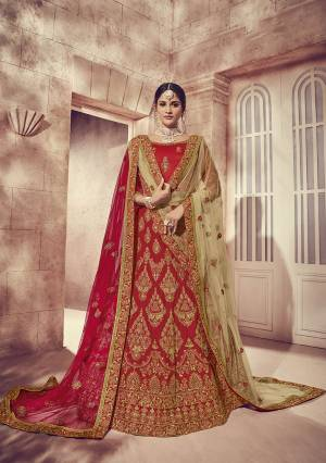 Here Is A Perfect Bridal Look For You With This Heavy designer Lehenga Choli In Red Color. This Lehenga Choli Is Silk Based Paired With Net Fabricated Dupatta Two Dupattas, One In Red And Another In Beige Color. Its Fabric Also Ensures Superb Comfort Throughout The Gala.