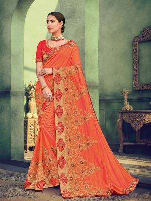 All the Fashionable women will surely like to step out in style wearing this orange color two tone silk saree. this gorgeous saree featuring a beautiful mix of designs. look gorgeous at an upcoming any occasion wearing the saree. Its attractive color and designer heavy embroidered saree, Flower patch design, stone design, beautiful floral design work over the attire & contrast hemline adds to the look. Comes along with a contrast unstitched blouse.
