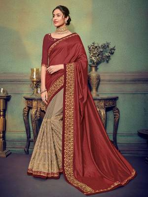 Presenting this maroon and Grey color two tone silk and bright georgette saree. Ideal for party, festive & social gatherings. this gorgeous saree featuring a beautiful mix of designs. Its attractive color and designer heavy embroidered saree, stone design, beautiful floral design work over the attire & contrast hemline adds to the look. Comes along with a contrast unstitched blouse.