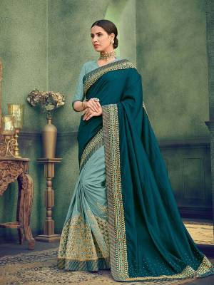 Flaunt a new ethnic look wearing this Teal And Steel Blue color two tone silk and two tone silk fabrics saree. this party wear saree won't fail to impress everyone around you. this gorgeous saree featuring a beautiful mix of designs. Its attractive color and designer heavy embroidered saree, stone design, beautiful floral design work over the attire & contrast hemline adds to the look. Comes along with a contrast unstitched blouse.