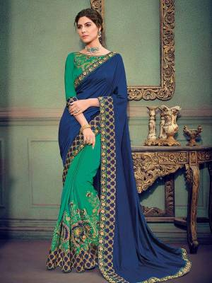 you Look striking and stunning after wearing this Royal Blue and green color two tone silk and two tone silk fabrics saree. look gorgeous at an upcoming any occasion wearing the saree. this party wear saree won't fail to impress everyone around you. Its attractive color and designer heavy embroidered saree, stone design, beautiful floral design work over the attire & contrast hemline adds to the look. Comes along with a contrast unstitched blouse.