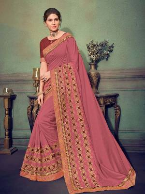 Flaunt a new ethnic look wearing this Pink color silk fabrics saree. Ideal for party, festive & social gatherings. this gorgeous saree featuring a beautiful mix of designs. Its attractive color and designer heavy embroidered saree, stone design, beautiful floral design work over the attire & contrast hemline adds to the look. Comes along with a contrast unstitched blouse.