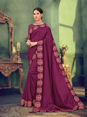Impress everyone with your amazing Trendy look by draping this Wine color silk fabrics saree. this party wear saree won't fail to impress everyone around you. this gorgeous saree featuring a beautiful mix of designs. Its attractive color and designer heavy embroidered saree, stone design, beautiful floral design work over the attire & contrast hemline adds to the look. Comes along with a contrast unstitched blouse.