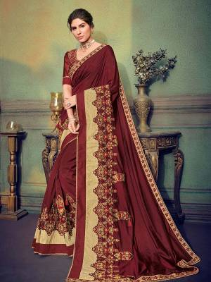 Classy, sensuous and versatile are the perfect words to describe this maroon color two tone silk fabrics saree. Ideal for party, festive & social gatherings. this gorgeous saree featuring a beautiful mix of designs. Its attractive color and designer heavy embroidered saree, stone design, beautiful floral design work over the attire & contrast hemline adds to the look. Comes along with a contrast unstitched blouse.