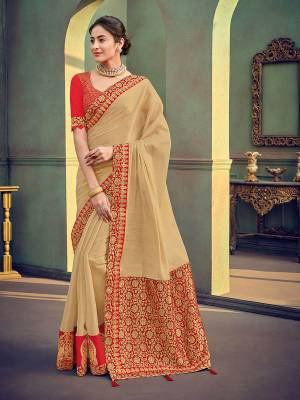 The fabulous pattern makes this beige color shimmer georgette saree. Ideal for party, festive & social gatherings. this gorgeous saree featuring a beautiful mix of designs. Its attractive color and designer heavy embroidered saree, stone design, beautiful floral design work over the attire & contrast hemline adds to the look. Comes along with a contrast unstitched blouse.