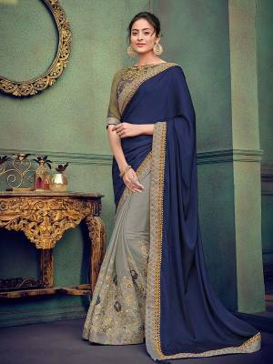 Presenting this Navy Blue and grey color silk fabrics and georgette saree. Ideal for party, festive & social gatherings. this gorgeous saree featuring a beautiful mix of designs. Its attractive color and designer heavy embroidered saree, stone design, beautiful floral design work over the attire & contrast hemline adds to the look. Comes along with a contrast unstitched blouse.