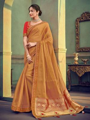 Change your wardrobe and get classier outfits like this gorgeous beige color two tone simmer georgette saree. Ideal for party, festive & social gatherings. this gorgeous saree featuring a beautiful mix of designs. Its attractive color and designer heavy embroidered saree, stone design, beautiful floral design work over the attire & contrast hemline adds to the look. Comes along with a contrast unstitched blouse.