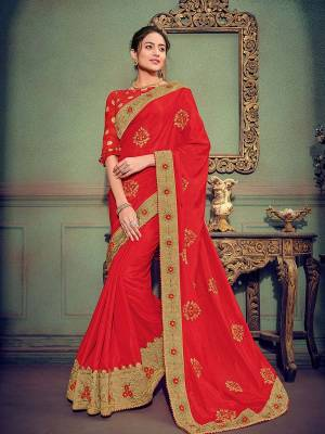 Show your elegance by wearing this gorgeous red color silk fabrics saree. Ideal for party, festive & social gatherings. this gorgeous saree featuring a beautiful mix of designs. Its attractive color and designer heavy embroidered saree, stone design, beautiful floral design work over the attire & contrast hemline adds to the look. Comes along with a contrast unstitched blouse.