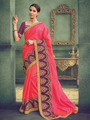Attractively Gorgeous mesmerizing is what you will look at the next wedding gala wearing this beautiful pink color two tone silk saree. Ideal for party, festive & social gatherings. this gorgeous saree featuring a beautiful mix of designs. Its attractive color and designer heavy embroidered saree, stone design, beautiful floral design work over the attire & contrast hemline adds to the look. Comes along with a contrast unstitched blouse.