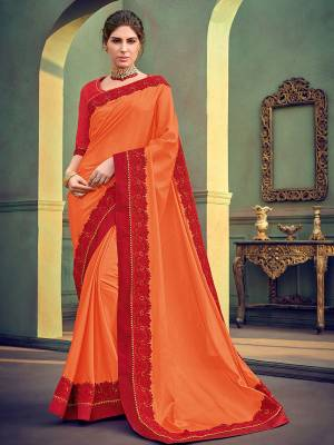 Flaunt your gorgeous look wearing this orange color georgette with glitter saree. Ideal for party, festive & social gatherings. this gorgeous saree featuring a beautiful mix of designs. Its attractive color and designer heavy embroidered saree, stone design, beautiful floral design work over the attire & contrast hemline adds to the look. Comes along with a contrast unstitched blouse.