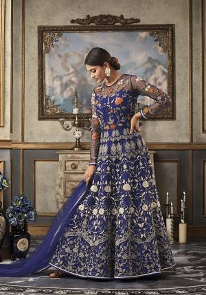 Shine Bright Wearing This Heavy Designer Floor Length Suit In Royal Blue Color Paired With Royal Blue Colored Bottom And Dupatta. Its Top And Dupatta Are Net Fabricated Paired With Art Silk Bottom And Inner. Its top Is Beautified With Heavy Contrasting Work All Over.