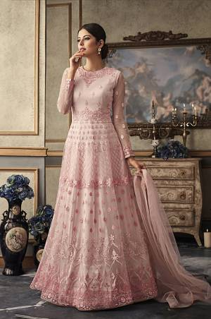 Look The Prettiest Of All Wearing This Heavy Designer Floor Length Suit In Baby Pink Colored Top Paired With Baby Pink Colored Bottom And Dupatta. Its Top Is Fabricated On Net Beautified With Heavy Embroidery Paired With Art Silk  Bottom And Net Dupatta. Buy Now.