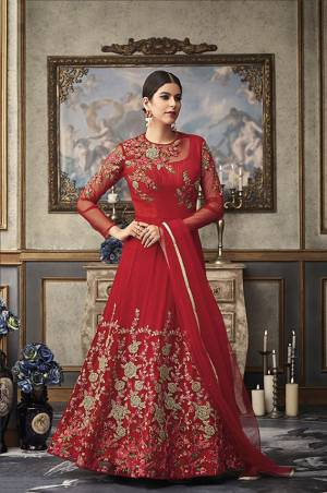 Adorn The Pretty Angelic Wearing This Heavy Designer Floor Length Suit In Red Color Paired With Red Colored Bottom And Dupatta. Its Top And Dupatta Are Fabricated On Net Beautified With Heavy Embroidery Paired With Art Silk Fabricated Bottom .