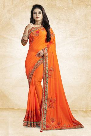 Get Ready For The Upcoming Festive And Season With This Designer Saree In Orange Color Paired With Orange Colored Blouse. This Saree Is Fabricated On Satin Silk Paired With Art Silk Fabricated Blouse. It Is Beautified With Attractive Embroidery Over The Saree.