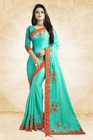 Get Ready For The Upcoming Festive And Season With This Designer Saree In Turquoise Blue Color Paired With Turquoise Blue Colored Blouse. This Saree Is Fabricated On Satin Silk Paired With Art Silk Fabricated Blouse. It Is Beautified With Attractive Embroidery Over The Saree.