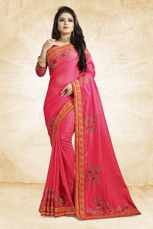 Get Ready For The Upcoming Festive And Season With This Designer Saree In Dark Pink Color Paired With Dark Pink Colored Blouse. This Saree Is Fabricated On Satin Silk Paired With Art Silk Fabricated Blouse. It Is Beautified With Attractive Embroidery Over The Saree.