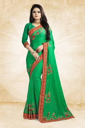 Get Ready For The Upcoming Festive And Season With This Designer Saree In Green Color Paired With Green Colored Blouse. This Saree Is Fabricated On Satin Silk Paired With Art Silk Fabricated Blouse. It Is Beautified With Attractive Embroidery Over The Saree.