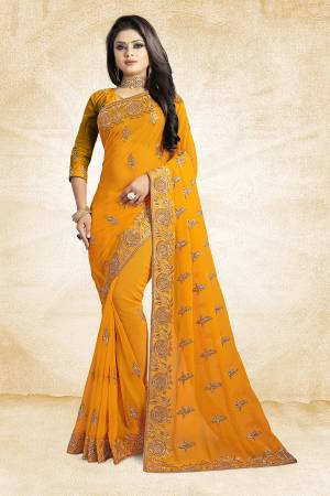 For A Heavy And Elegant Look, This Saree Is Perfect For Your Choice. Grab This Deisgner Saree In Musturd Yellow Color Paired With Musturd Yellow Colored Blouse. This Saree Is Fabricated On Georgette Beautified With Heavy Embroidery Paired With Art Silk Fabricated Blouse.