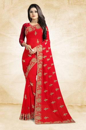 For A Heavy And Elegant Look, This Saree Is Perfect For Your Choice. Grab This Deisgner Saree In Red Color Paired With Red Colored Blouse. This Saree Is Fabricated On Georgette Beautified With Heavy Embroidery Paired With Art Silk Fabricated Blouse.
