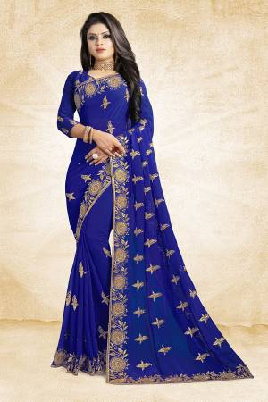 For A Heavy And Elegant Look, This Saree Is Perfect For Your Choice. Grab This Deisgner Saree In Royal Blue Color Paired With Royal Blue Colored Blouse. This Saree Is Fabricated On Georgette Beautified With Heavy Embroidery Paired With Art Silk Fabricated Blouse.