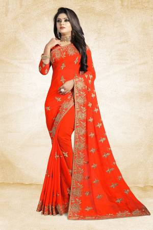 For A Heavy And Elegant Look, This Saree Is Perfect For Your Choice. Grab This Deisgner Saree In Orange Color Paired With Orange Colored Blouse. This Saree Is Fabricated On Georgette Beautified With Heavy Embroidery Paired With Art Silk Fabricated Blouse.