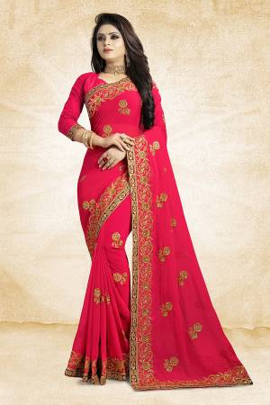 Add This Beautiful Designer Saree To Your Wardrobe In Dark Pink Color Paired With Dark Pink Colored Blouse. This Pretty Embroidered Saree Is Georgette Based Paired With Art Silk Fabricated Blouse. It Is Light Weight and Easy To Drape. Buy Now.