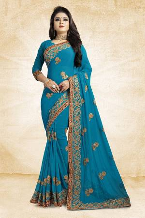 Add This Beautiful Designer Saree To Your Wardrobe In Blue Color Paired With Blue Colored Blouse. This Pretty Embroidered Saree Is Georgette Based Paired With Art Silk Fabricated Blouse. It Is Light Weight and Easy To Drape. Buy Now.