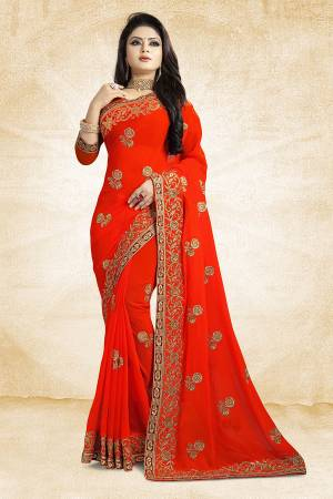 Add This Beautiful Designer Saree To Your Wardrobe In Orange Color Paired With Orange Colored Blouse. This Pretty Embroidered Saree Is Georgette Based Paired With Art Silk Fabricated Blouse. It Is Light Weight and Easy To Drape. Buy Now.